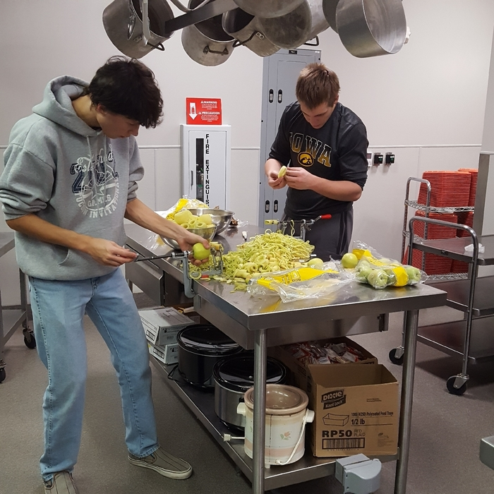 Hard at work slicing & peeling apples