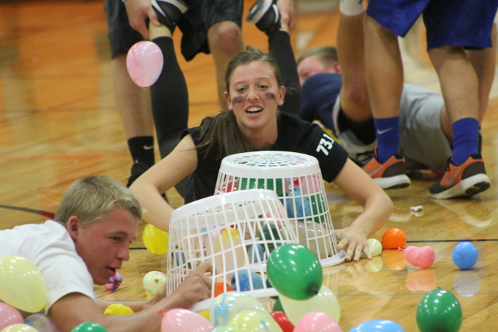 "Senior Hailey Messerich and Junior Devin Said battling during the ""hungry Hippo"" game on Monday."
