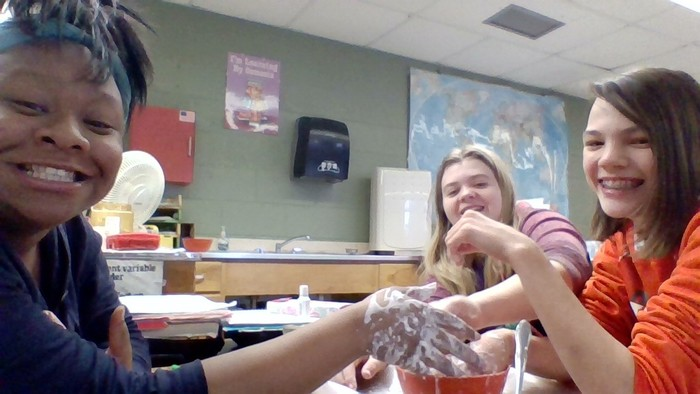 The eighth graders having fun in science class making ooblek.