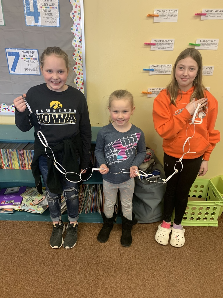 These girls and boys synergized to make the longest paper chain using 1 piece of paper!